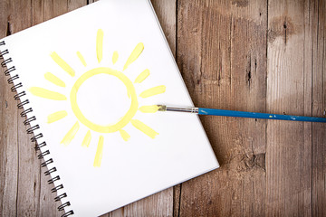 painting of sun on notebook