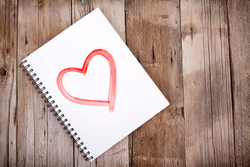Painting of heart on notebook