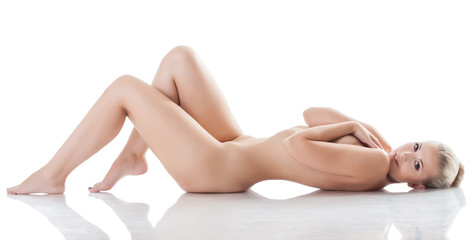 Amazing naked blonde smiling lying in studio