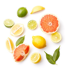 Various Citrus Fruits On White