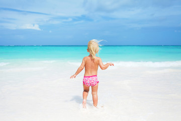 Happy child on the coast of tropical sea