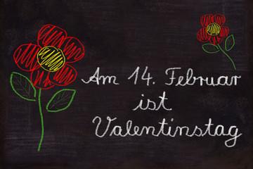 Schultafel, Blumen und Text, Am 14. Februar ist Valentinstag