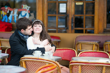 Loving couple in a Parisian cafe