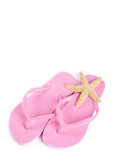 Pink Flip Flops and Starfish Isolated on White