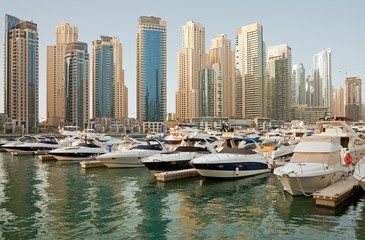 Luxurious Yachts and Boats in Front of Dubai Marina Skyscrapers