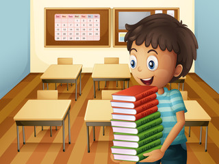 A boy carrying a pile of books