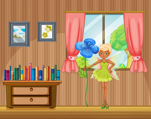 A fairy holding a flower inside the house