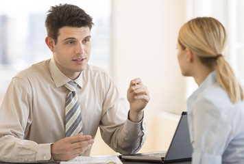 Businessman Discussing With Colleague In Meeting At Office