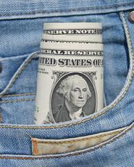 Banknotes dollars in jeans pocket