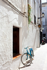 blue bicycle at a white wall