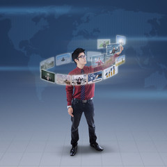 Businessman touch digital picture on blue world map