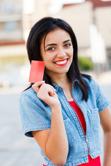 Credit Card Held by Girl