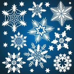 Vector snowflakes isolated on blue background.
