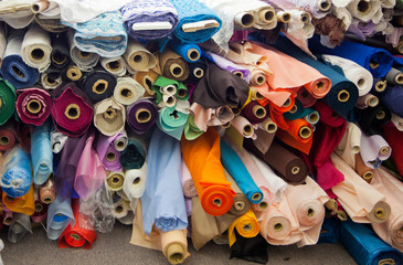 Bolts/rolls of various colored fabric