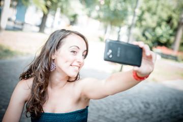 beautiful woman taking self-portrait