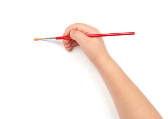paintbrush in child hand