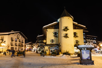 Fototapete - Illuminated Central Square of Megeve in French Alps, France