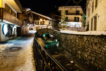 Fototapete - Illuminated Street of Megeve in French Alps, France