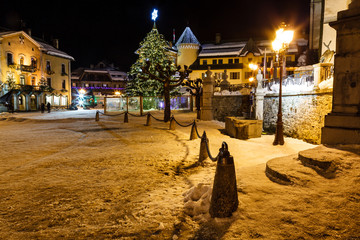 Wall Mural - Illuminated Christmas Tree on Central Square of Megeve in French