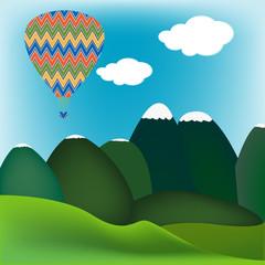 Hot air ballon over a mountain landscape