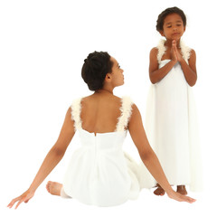 Beautiful black mother daughter portrait. Dressed as angels. Mom