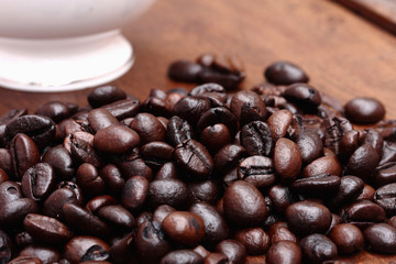 Coffee beans with coffee. wood background