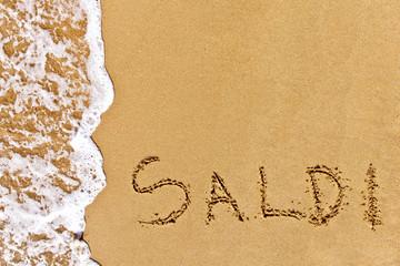 written saldi drawn on the sand
