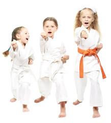 Athletes dressed in white kimono beat hand