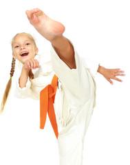 Sportswoman in white kimono perform a kick