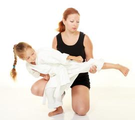 Mom teaches daughter punch kicking karate