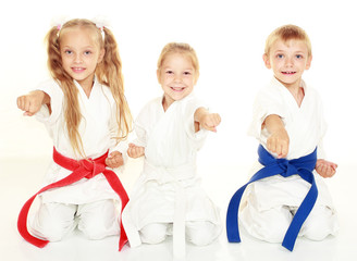 Children to sit in a ceremonial kimono karate pose and hit