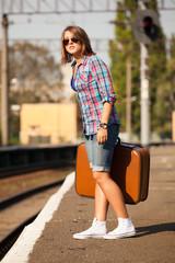 Hipster girl at railways platform.