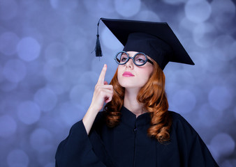 graduating student girl in an academic gown.