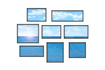 several windows on a white wall with sea landscape