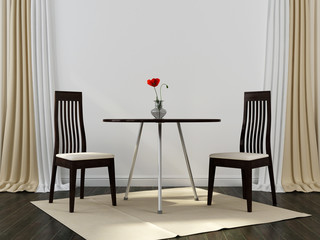 Two black chairs and a table
