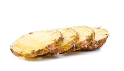 Row sliced pineapple on a white background.