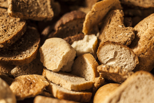 Many slices of stale bread and other baked goods.