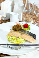 Baked salmon fillet with vegetables in a restaurant