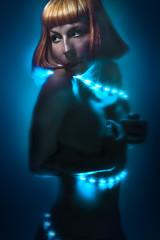 Sensuality, beautiful woman over blue neon light, glow effects