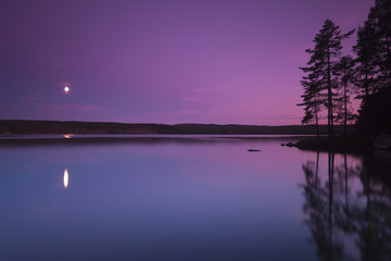 Moonlight over a Swedish lake, the moon are reflecting