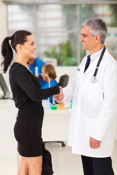medical rep handshaking with senior doctor