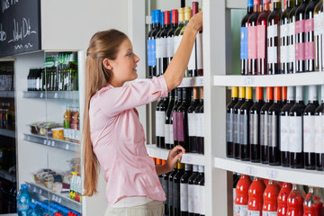 Young Woman Shopping For Alcohol
