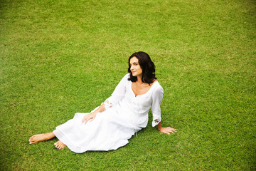 woman in white clothes on the grass