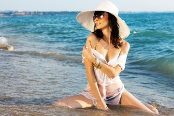 The beautiful girl on sea coast