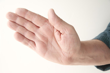 older man holding a hand out at an angle