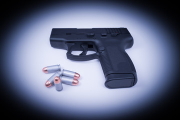 Hand Gun - Spotlighted 45 Auto and Bullets