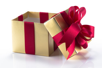 Beautiful gold present box with red bow and ribbons