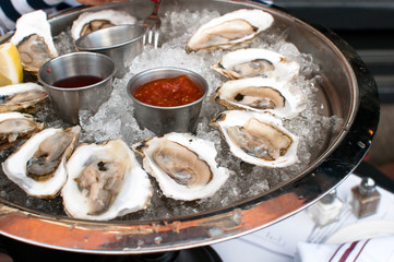 Oysters served raw with sauces