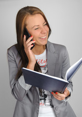 Woman talking by cell phone and smiling.