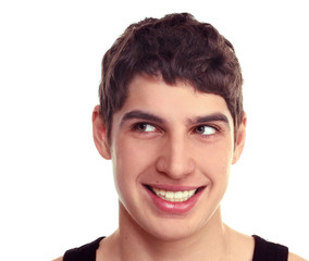 Close-up of a young guy smiling  looking sideways Isolate on whi